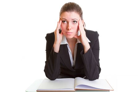 hardly: Businesswoman hardly studying from the book on the desk
