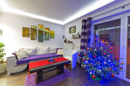 Modern living room interior with Christmas tree Stock Photo