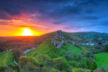 dorset: Ruins of the Corfe castle at beautiful sunrise in County Dorset, UK Stock Photo