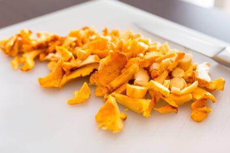 golden chanterelle: Sliced golden chanterelle fungus on the cutting board