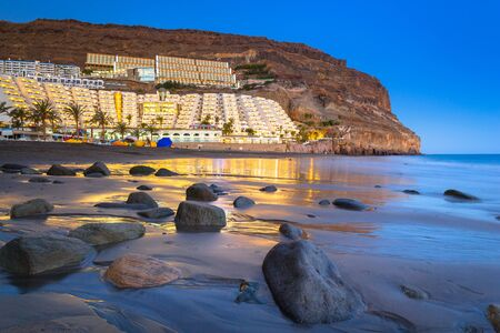 Atlantic beach of Gran Canaria island in Taurito at dusk, Spain
