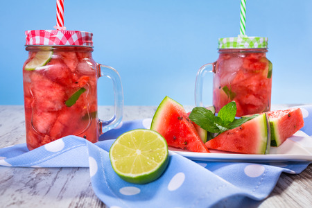 sliced watermelon: Watermelon and lime lemonades on kitchen table