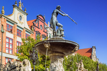 neptun: GDANSK, POLAND - SEPTEMBER 8, 2016: Fountain of the Neptune in old town of Gdansk, Poland. The bronze statue of Neptune made in 16th century is one the most recognizable symbols of Gdansk.