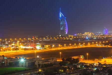 DUBAI, UAE - 3 APRIL 2014: Burj Al Arab hotel in Dubai at night, UAE. Burj Al Arab with 321 meters high is the most luxurious 7 star hotel and a symbol of modern Dubai.
