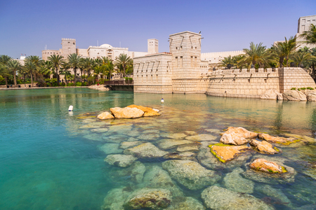 hectares: DUBAI, UAE - 1 APRIL 2014: Architecture of Madinat Jumeirah resort in Dubai, UAE. Madinat Jumeirah is 5 star resort in Dubai and the largest resort in the emirate with over 40 hectares of gardens.