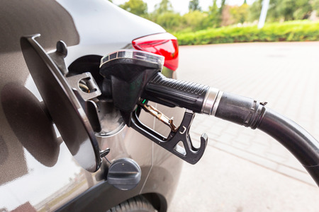 refilling: Refilling car fuel on the gas station Stock Photo