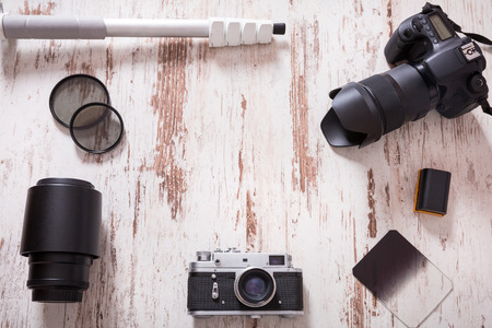 photography background: Travel photography background with cameras, monopod, filters and bateries