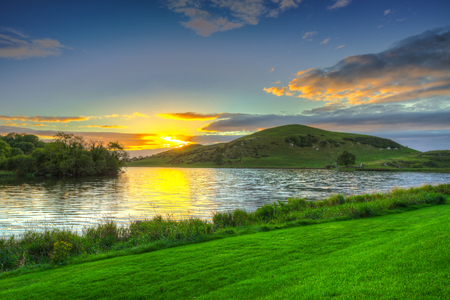 Idyllic sunset scenery at Lough Gur lake in Ireland Stock Photo