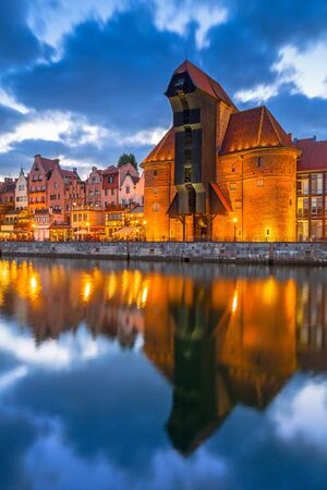 reflection: Old town of Gdansk with ancient crane at dusk, Poland