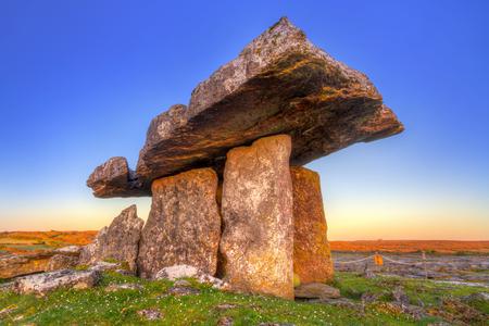 burren: Poulnabrone portal tomb in Burren at sunrise, Ireland Stock Photo