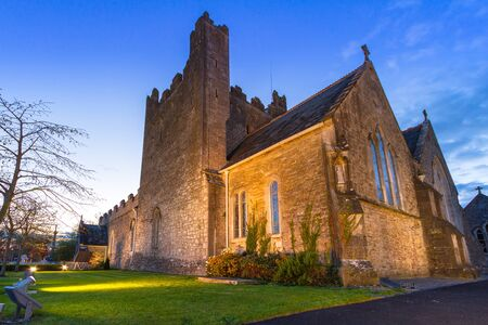 Holy Trinity Abbey church in Adare at night, Co. Limerick, Ireland
