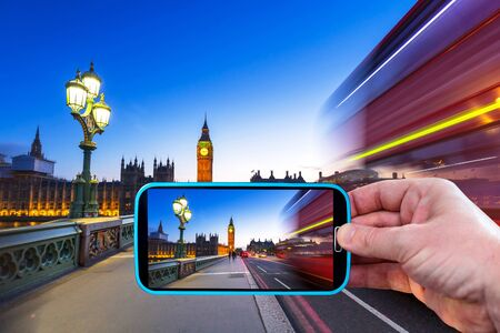 Making photos by smartphone in London at night, UK Stock Photo