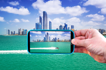 Making photos by smartphone in Abu Dhabi, UAE Stock Photo