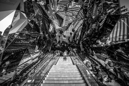 omotesando: TOKYO, JAPAN - NOVEMBER 12, 2016: Mirror entrance to Tokyu Plaza Fashion shopping centre in Tokyo, Japan. Tokyu Plaza Omotesando Harajuku is located in popular shoping Shibuya district of Tokyo.
