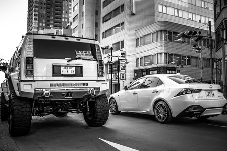 populous: TOKYO, JAPAN - NOVEMBER 12, 2016: Luxury cars on the street of Ikebukuro district of Tokyo, Japan. Tokyo Metropolis is both the capital and most populous city of Japan. Editorial
