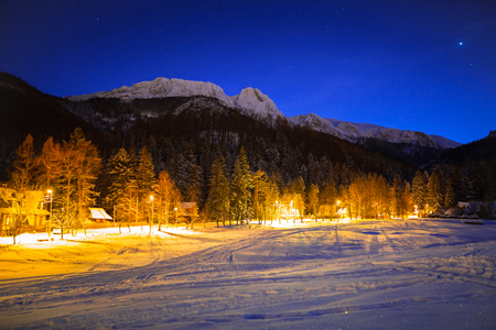 giewont: Strażyska valley and Giewont in Tatra mountains at night. Silhouette of sleeping knight.