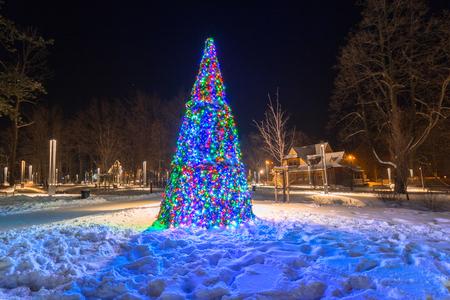 colourful lightings: Beautiful Christmas tree in the park of Zakopane, Poland Stock Photo