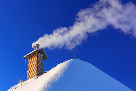 Chimney of the house at winter season with ecological gas smoke