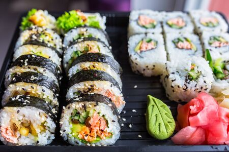 Set of futomaki sushi with grilled salmon Stock Photo