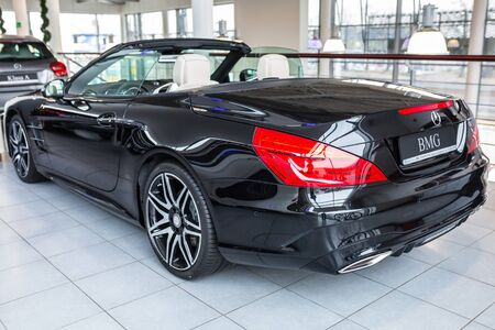 GDANSK, POLAND - JANUARY 30, 2017: Brand new 2017 model of Mercedes SL63 AMG cabrio in the car showroom of Gdansk, Poland. AMG SL63 is a convertible roadster witk 5.5 litre engine and 585 power horses