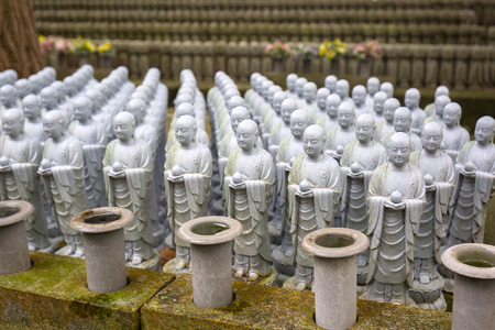 Rows of similar Japanese Jizo sculptures in Kamakura, Japan Stock Photo