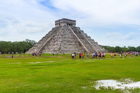 CHICHEN ITZA, MEXICO - JULY 12, 2011: Uknown people visiting Kukulkan pyramid in Chichen Itza, Yucatan. Kukulkan pyramid is one of seven New World Wonders and popular tourist destination in Mexico. Editorial