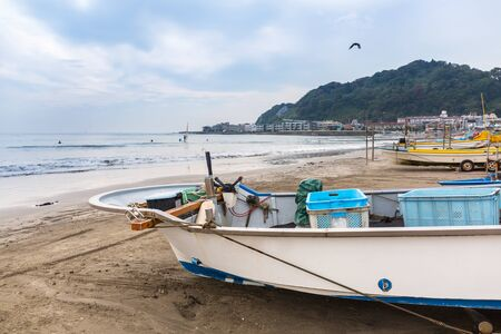 Fishing boat on the coast of Pacific ocean in Kamakura, Japan Stock Photo