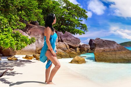 Woman enjoing sun holidays at the tropical beach Stock Photo