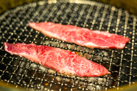 Yakiniku style barbecue beef on the grill Stock Photo - 76033770