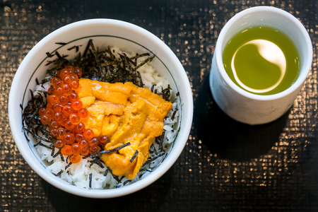 Japanese dish of salmon roe and urchin eggs with rice