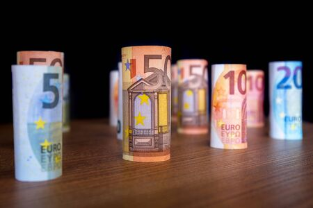 Rolled up euro banknotes on the desk Stock Photo - 75205960