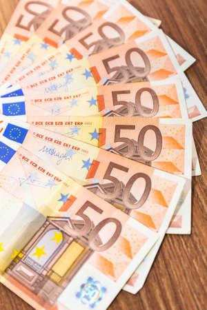 Fifty euro banknotes on the desk Stock Photo - 75205958