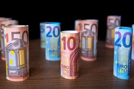 Rolled up euro banknotes on the desk Stock Photo - 75224868