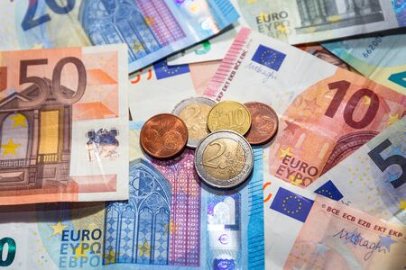 Euro money banknotes and coins Stock Photo - 76153408
