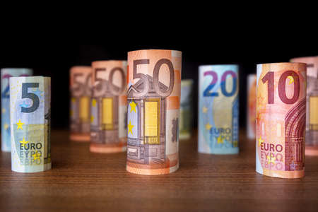 Rolled up euro banknotes on the desk Stock Photo - 75164559