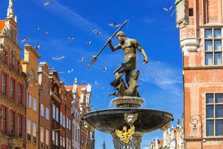 Fountain of the Neptune in old town of Gdansk, Poland Фото со стока