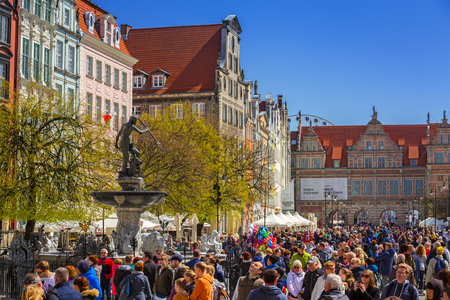 neptuno: GDANSK, POLAND - MAY 2, 2017: Fountain of the Neptune in old town of Gdansk, Poland. The bronze statue of Neptune made in 16th century is one the most recognizable symbols of Gdansk. Editorial