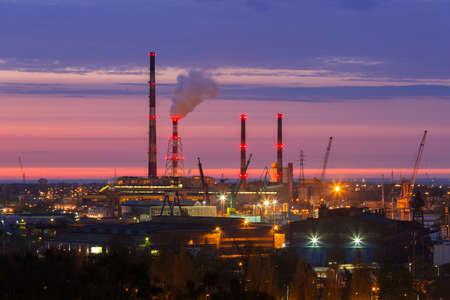 Chimneys of heating plant in Gdansk at sunset, Poland