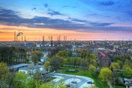 Cranes of the shipyard in Gdansk at sunset, Poland Stock Photo