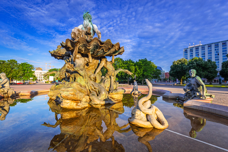 The Neptune Fountain in Berlin at sunrise, Germany Stock Photo