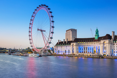 Night scenery of London Eye at the Thames river in London, UK