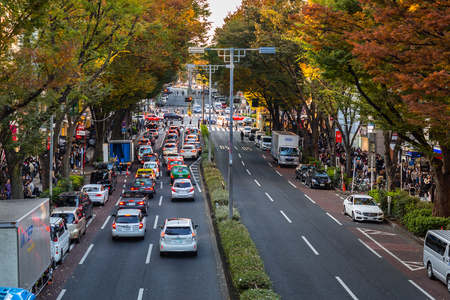 manufacturer: TOKYO, JAPAN - NOVEMBER 12, 2016: Cars in traffic on the street of Tokyo, Japan. Tokyo Metropolis is both the capital and most populous city of Japan.