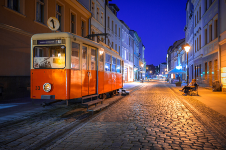 tramway: BYDGOSZCZ, POLAND - AUGUST 1, 2017: Bydgoszcz city with old tram used as tourist information at night, Poland. Bydgoszcz is the city with beautiful neo-gothic and neo-baroque architecture. Editorial