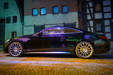 BYDGOSZCZ, POLAND - AUGUST 1, 2017: New 2017 model of Mercedes C-klasse coupe on the street of Bydgoszcz at night, Poland. Mercedes-Benz is German luxury  automobile manufacturer located in Stuttgart.