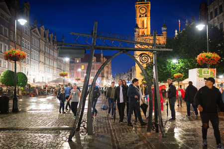 street lamp: GDANSK, POLAND - JULY 27, 2017: People on the Long Lane of the old town in Gdansk at night, Poland. Gdansk is the historical capital of Polish Pomerania.