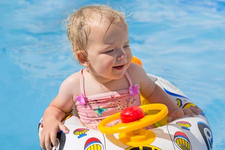 Little girl having fun in summer swimming pool