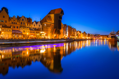 Gdansk at night with historic port crane reflected in Motlawa river, Poland Stock Photo