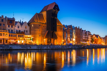 Gdansk at night with historic port crane reflected in Motlawa river, Poland Фото со стока