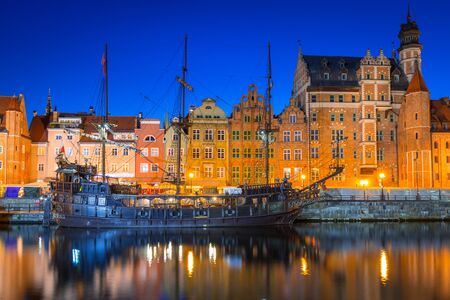 GDANSK, POLAND - AUGUST 14, 2017: Pirate ship at the Motlawa river in Gdansk. Port crane in Gdansk built between 1442 and 1444 is the city symbol and the oldest surviving port crane in Europe.