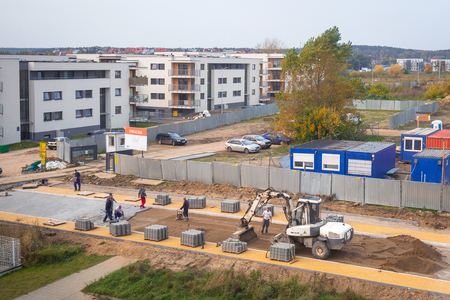 PRUSZCZ GDANSKI, POLAND - OCTOBER 17, 2017: Workers building new cobble road at residential area in Pruszcz Gdanski, Poland. Pruszcz Gdanski is growing industrial town neighbouring to Gdansk.